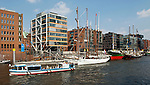 Hamburg-Germany - May 04, 2013 -- HafenCity within the port / harbour at river Elbe; here, apartment buildings on Sandtorkai and ships / sailing boats lying in the Sandtorhafen -- Photo: © HorstWagner.eu