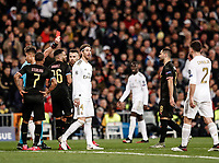 26th February 2020; Estadio Santiago Bernabeu, Madrid, Spain; UEFA Champions League Football, Real Madrid versus Manchester City; Sergio Ramos (Real Madrid)  is shown a red card for pulling back Jesus