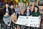 Katie Walsh presented the proceeds of the Jimmy O'Briens bar hamper draw to Breda Dyland for the Kerry Cork Health link bus in the bar on Sunday with front row Alan Breen Trish Kelly and Charlie Buckingham. Back row: Larry Hickey, Pat Culloty, Eddie Phillips and Tony Fleming