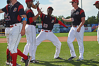 Batavia Muckdogs Javier Lopez (23) jokes around in between Victor Delgado (27) and Trenton Hill (39) after a game against the Staten Island Yankees on August 28, 2016 at Dwyer Stadium in Batavia, New York.  Batavia defeated Staten Island 6-0. (Mike Janes/Four Seam Images)