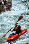 Kayakers paddle down the Gallatin River in Montana. People kayak on the Gallatin Rvier, between Big Sky and Bozeman, Montana.
