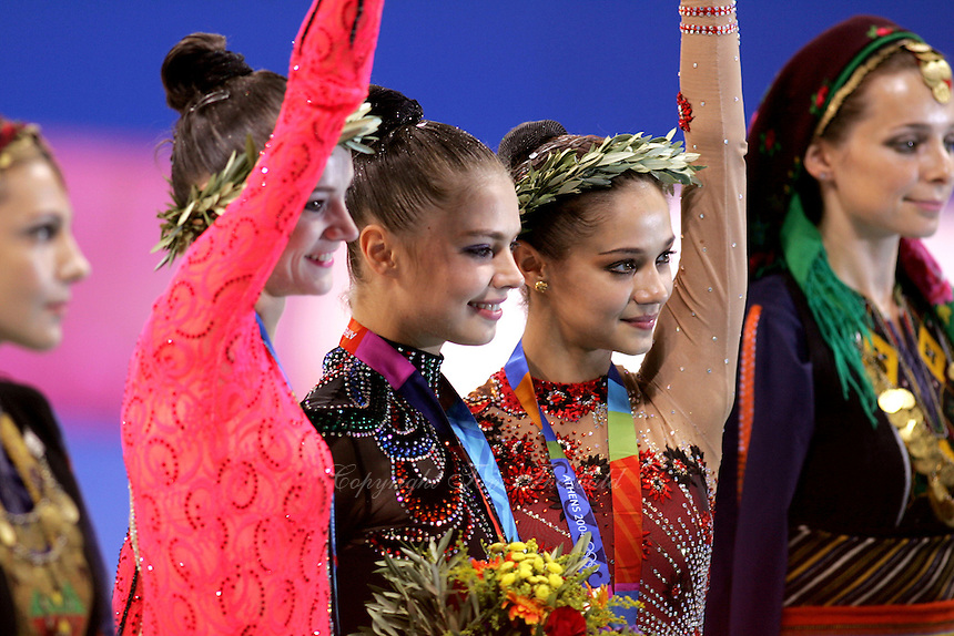 August 29, 2004; Athens, Greece; (L-R) Rhythmic gymnasts ANNA BESSONOVA of Ukraine, ALINA KABAEVA of Russia and IRINA TCHACHINA of Russia won bronze, gold, silver respectively in All-Around at 2004 Athens Olympics.<br />