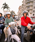 ITALY, Verona, portrait of teenage boys riding scooters