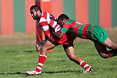 Siale Piutau looks to get the pass away as he is tackled by Misi Tupou. Counties Manukau Premier Club Rugby game bewtween Waiuk & Karaka played at Waiuku on Saturday April 11th, 2010..Karaka won the game 24 - 22 after leading 21 - 9 at halftime.