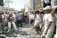 "A ""capo"" yells out instructions to the lifters (or ""Paranza"") at the annual Feast of Our Lady of Mount Carmel and the Dancing of the Giglio in Brooklyn, NY, on July 11, 2004."
