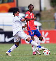Brayan Landaverde (6) of El Salvador fights for the ball with Jake Beckford (7) of Costa Rica during the group stage of the CONCACAF Men's Under 17 Championship at Jarrett Park in Montego Bay, Jamaica. Costa Rica defeated El Salvador, 3-2.