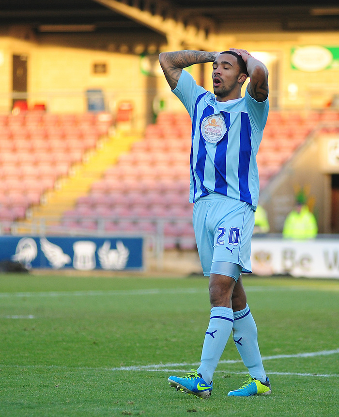 Coventry City's Callum Wilson shows his frustration after going close to scoring with a header<br /> <br /> Photo by Chris Vaughan/CameraSport<br /> <br /> Football - The Football League Sky Bet League One - Coventry City v Oldham Athletic - Sunday 29th December 2013 - Sixfields Stadium - Northampton<br /> <br /> &copy; CameraSport - 43 Linden Ave. Countesthorpe. Leicester. England. LE8 5PG - Tel: +44 (0) 116 277 4147 - admin@camerasport.com - www.camerasport.com