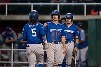 Ogden Raptors center fielder James Outman (47) congratulates Ronny Brito (5) after he hit a home run as Niko Hulsizer (12) looks on during a Pioneer League game against the Orem Owlz at Home of the OWLZ on August 24, 2018 in Orem, Utah. The Ogden Raptors defeated the Orem Owlz by a score of 13-5. (Zachary Lucy/Four Seam Images)