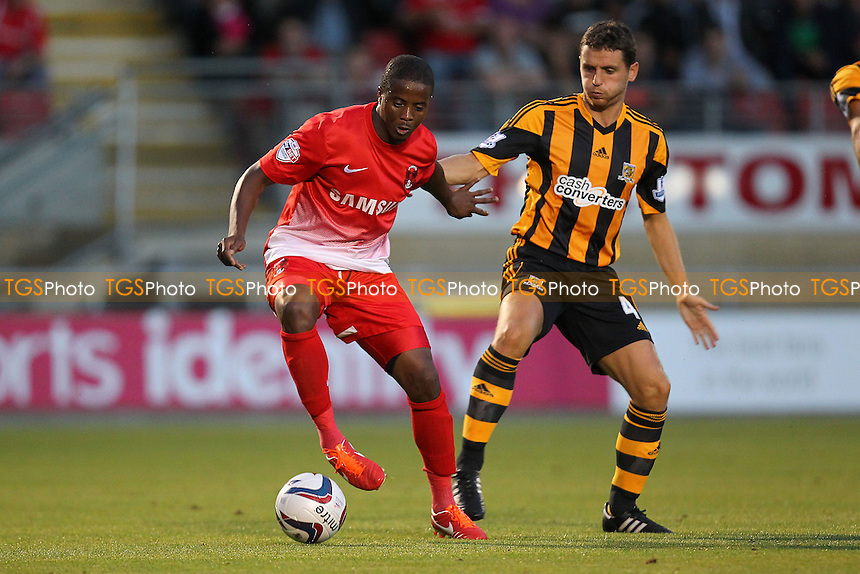 Kevin Lisbie of Leyton Orient seeks to evade Alex Bruce of Hull City - Leyton Orient vs Hull City - Capital One Cup Second Round Football at the Matchroom Stadium, Brisbane Road, Leyton, London - 27/08/13 - MANDATORY CREDIT: Gavin Ellis/TGSPHOTO - Self billing applies where appropriate - 0845 094 6026 - contact@tgsphoto.co.uk - NO UNPAID USE