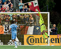 FOXBOROUGH, MA - SEPTEMBER 29: Gustavo Bao #7 of New England Revolution floats ball over Sean Johnson #1 of New York City FC for a score during a game between New York City FC and New England Revolution at Gillette Stadium on September 29, 2019 in Foxborough, Massachusetts.
