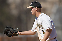 First baseman Austin Stadler #9 of the Wake Forest Demon Deacons on defense versus the Virginia Cavaliers at Wake Forest Baseball Park March 8, 2009 in Winston-Salem, NC. (Photo by Brian Westerholt / Four Seam Images)