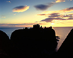 Dunnottar Castle, Nr Stonehaven, Aberdeenshire, Scotland. Uk.  Celtic Britain published by Orion. Its name implies that from early Pictish times this impressive cliff top castle was a fortified dun.
