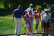 Bethesda, MD - June 25, 2016: PGA golfer Ernie Els greets a young fan as he walks to the 15th hole fairway during Round 3 of professional play at the Quicken Loans National Tournament at the Congressional Country Club in Bethesda, MD, June 25, 2016.  (Photo by Don Baxter/Media Images International)