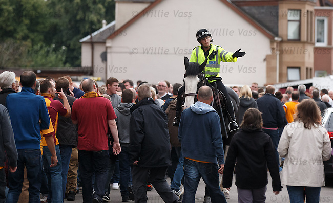 Police with fans trying to enter the ground just before kick-off