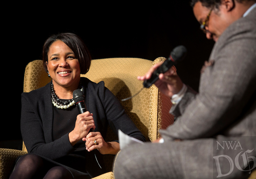 NWA Democrat-Gazette/JASON IVESTER<br /> Rosalind Brewer, Sam's Club president and chief executive officer, talks with Tony Walker with the NWA MLK Council on stage on Monday, Jan. 18, 2016, during the 20th annual Dr. Martin Luther King, Jr. Community Recommitment Banquet inside the Fayetteville Town Center.