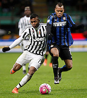 Calcio, Coppa Italia: semifinale di ritorno Inter vs Juventus. Milano, stadio San Siro, 2 marzo 2016. <br /> Juventus&rsquo; Alex Sandro, left, and FC Inter&rsquo;s Jonathan Biabiany fight for the ball during the Italian Cup second leg semifinal football match between Inter and Juventus at Milan's San Siro stadium, 2 March 2016.<br /> UPDATE IMAGES PRESS/Isabella Bonotto