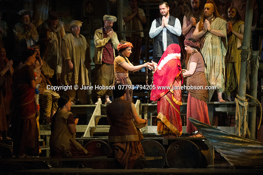 London, UK. 13.06.2014. Penny Woolcock's THE PEARL FISHERS returns to ENO, at the London Coliseum, as a co-production with the Metropolitan Opera, New York. Picture shows: George von Bergen (Zurga), Sophie Bevan (Leila) and Barnaby Rea (Nourabad). Photograph © Jane Hobson.