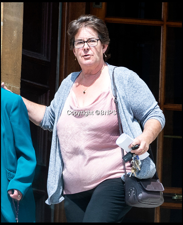 BNPS.co.uk (01202 558833)<br /> Pic:  BNPS <br /> <br /> Mandy Struthers-Gardner, civil partner of Elena Lindsay Struthers-Gardner, leaving the inquest at Bournemouth town hall today (Monday).<br /> <br /> A retired jockey died when she fell onto an eco-friendly metal drinking straw which impaled her eye, an inquest heard today.<br /> <br /> Elena Lindsay Struthers-Gardner, 60, suffered horrific brain injuries in the freak accident at her home in Broadstone, Poole, Dorset.<br /> <br /> She was carrying a mason-jar style drinking glass with a screw-top lid in her kitchen when she collapsed, with the 10ins stainless steel straw entering her left eye socket and piercing her brain.<br /> <br /> Today a coroner, prompted by the family, said metal drinking straws sould never be used with a lid that fixes them in place, and 'great care should be taken' while using them.