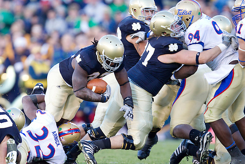 Notre Dame tailback/fullback Robert Hughes (#33) dives for extra yardage during NCAA football game between Tulsa and Notre Dame.  The Tulsa Golden Hurricane defeated the Notre Dame Fighting Irish 28-27 in game at Notre Dame Stadium in South Bend, Indiana.