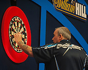 04.01.2015.  London, England.  William Hill PDC World Darts Championship.  Finals Night.  Phil Taylor (2) [ENG] removes his darts after a finishing double during his game against Gary Anderson (4) [SCO]