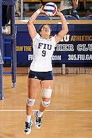 24 September 2010:  FIU's Natalia Valentin (9) sets up a shot in the second set as the FIU Golden Panthers defeated the University of Denver Pioneers, 3-0 (29-27, 25-16, 25-20), at U.S Century Bank Arena in Miami, Florida.