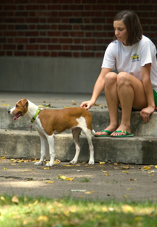 18373Campus photos by Kevin Riddell.Senior Political Science student Lindsay Camel pets her puppy, Paisley, Friday while relaxing on Temple Blackburn Alumni Memorial Auditorium's steps.