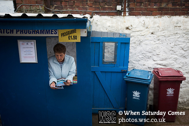 Clitheroe 0 Consett 1, 20/08/2016. Shawbridge, Northern Premier League Division One North. The programme seller waiting for spectators inside the ground before Clitheroe played Consett at Shawbridge in an FA Cup preliminary round tie. Northern Premier League division one north team Clitheroe were formed in 1877 and have played at the same ground since 1925. Visitors Consett, from the Northern League division one, won the match 1-0, watched by 207 spectators. Photo by Colin McPherson.