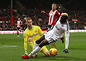 2nd December 2017, Griffen Park, Brentford, London; EFL Championship football, Brentford versus Fulham; Sheyi Ojo of Fulham attempting to dive in front of Goalkeeper Daniel Bentley of Brentford to look for a penalty