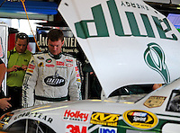 Oct 3, 2008; Talladega, AL, USA; NASCAR Sprint Cup Series driver Dale Earnhardt Jr looks under the hood of his car after blowing an engine during practice for the Amp Energy 500 at the Talladega Superspeedway. Mandatory Credit: Mark J. Rebilas-
