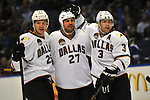 Dallas Stars left wing Matt Fraser (25, left) and Dallas Stars defenseman Stephane Robidas (3, right) congratulate Dallas Stars defenseman Aaron Rome (27) after he scored  in the third period during a game between the Dallas Stars and the St. Louis Blues on Friday April 19, 2013 at the Scottrade Center in downtown St. Louis.  The Blues won, 2-1.
