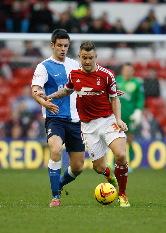 Blackburn's Scott Dann (L) and Nottingham Forest's Simon Cox in action during todays match  <br /> <br /> Photo by Jack Phillips/CameraSport<br /> <br /> Football - The Football League Sky Bet Championship - Nottingham Forest v Blackburn Rovers - Saturday 18th January 2014 - The City Ground - Nottingham<br /> <br /> &copy; CameraSport - 43 Linden Ave. Countesthorpe. Leicester. England. LE8 5PG - Tel: +44 (0) 116 277 4147 - admin@camerasport.com - www.camerasport.com