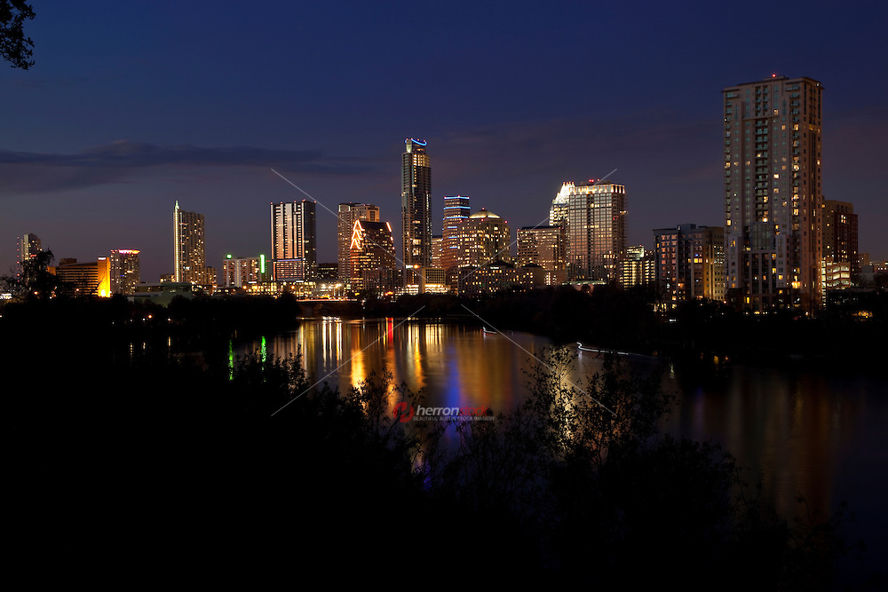 Scenic view of the Austin, Texas downtown skyline and lake reflection at sunset