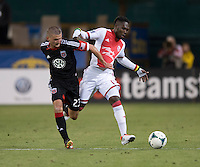 Perry Kitchen (23) of D.C. United fights for the ball with Kalif Alhassan (11) of the Portland Timbers during a Major League Soccer match at RFK Stadium in Washington, DC.  The Portland Timbers defeated D.C. United, 2-0.