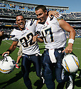 Philip Rivers, right, and Eric Weddle celebrate their win at Qualcomm Stadium over Minnesota in 2011.    photo for the North County Times