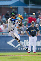 Akron Rubber Ducks third baseman Ronny Rodriguez (15) makes a throw to first base against the Reading Fightin Phils at FirstEnergy Stadium on June 19, 2014 in Wappingers Falls, New York.  The Rubber Ducks defeated the Fightin Phils 3-2.  (Brian Westerholt/Four Seam Images)