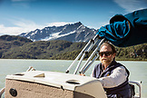 USA, Alaska, Redoubt Bay, Big River Lake, one of the bear biolgists driving the boat back from Wolverine Cove