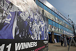 A poster of the 2011 League Cup winning team on display outside the Spion Kop stand at St. Andrew's stadium with the city's skyline in the distance, prior to Birmingham City's Barclay's Premier League match with Wolverhampton Wanderers. Both clubs were battling against relegation from  England's top division. The match ended in a 1-1 draw, watched by a crowd of 26,027.