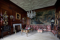 The anteroom is lined with early eighteenth century chairs and a daybed in original velvet coverings