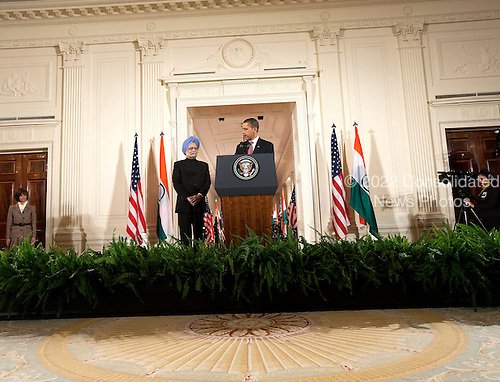 Washington, DC - November 24, 2009 -- United States President Barack Obama speaks as Manmohan Singh, left, India's prime minister, watches during an arrival ceremony at the White House in Washington, D.C., U.S., on Tuesday, November 24, 2009..Credit: Joshua Roberts - Pool via CNP