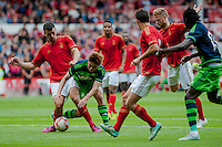 NOTTINGHAM, ENGLAND - JULY 25: Ki Sung-Yueng of Swansea City  battles through the Forest Defence  during the pre season friendly match between Nottingham Forest and Swansea City at The City Ground on July 25, 2015 in Nottingham, England.  (Photo by Aled Llywelyn / Athena Pictures )