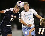 9 November 2007: Virginia's Nikki Krzysik (23) blocks a headed shot from North Carolina's Whitney Engen (9). The University of North Carolina tied the University of Virginia 1-1 at the Disney Wide World of Sports complex in Orlando, FL in an Atlantic Coast Conference tournament semifinal match.  UNC advanced to the finals on penalty kicks, 4-2.