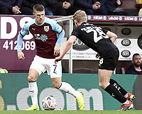 Burnley's Johann Gudmundsson under pressure from Barnsley's Ben Williams<br /> <br /> Photographer Rich Linley/CameraSport<br /> <br /> Emirates FA Cup Third Round - Burnley v Barnsley - Saturday 5th January 2019 - Turf Moor - Burnley<br />  <br /> World Copyright &copy; 2019 CameraSport. All rights reserved. 43 Linden Ave. Countesthorpe. Leicester. England. LE8 5PG - Tel: +44 (0) 116 277 4147 - admin@camerasport.com - www.camerasport.com