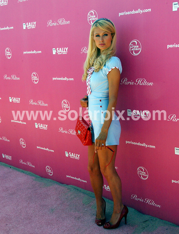 **ALL ROUND PICTURES FROM SOLARPIX.COM**.**SYNDICATION RIGHTS FOR UK, SPAIN, PORTUGAL, AUSTRALIA, S.AFRICA & DUBAI (U.A.E) ONLY**.arrivals for the Sally Beauty Supply launch The Bandit from Dreamcatchers, at a Private Location, Malibu, California, USA. 23rd August 2008..This pic: Paris Hilton..JOB REF: 7101 PHZ/Albert L. Ortega    .DATE: 23_08_2008.**MUST CREDIT SOLARPIX.COM OR DOUBLE FEE WILL BE CHARGED* *UNDER NO CIRCUMSTANCES IS THIS IMAGE TO BE REPRODUCED FOR ANY ONLINE EDITION WITHOUT PRIOR PERMISSION*