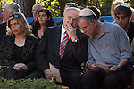 Israeli Prime Minister Benjamin Netanyahu (C) and his wife, Sarah Netanyahu (L) at the memorial service for his brother, Yoni Netanyahu at Mt. Hertzel in Jerusalem, Sunday, June 28, 2009. Lieutenant Colonel Yoni Netanyahu was killed during a rescue mission in Entebbe, Uganda in 1976, where hijacked Israelis and Jewish passengers from an Air France flight were held hostage. Photo By: Tess Scheflan / JINI