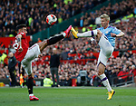 Bruno Fernandes of Manchester United tackles Oleksandr Zinchenko of Manchester City during the Premier League match at Old Trafford, Manchester. Picture date: 8th March 2020. Picture credit should read: Darren Staples/Sportimage