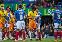 Sido Jombati of Wycombe Wanderers tells teammates he is taking the free kick under protest and scores during the Sky Bet League 2 match between Portsmouth and Wycombe Wanderers at Fratton Park, Portsmouth, England on 23 April 2016. Photo by Andy Rowland.