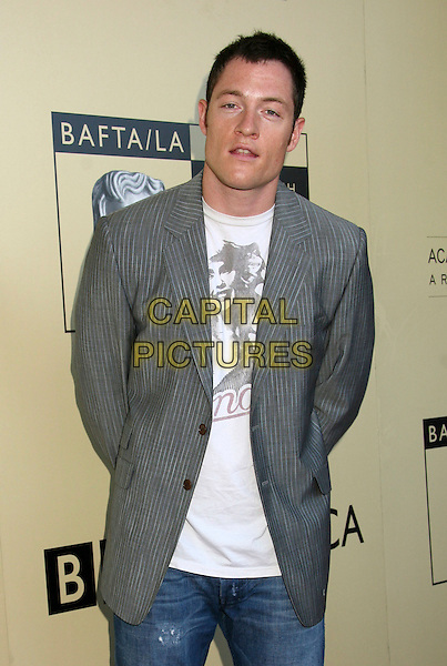 TAHMOH PENIKETT.BAFTA LA and the Academy of Television Arts And Sciences Host Primetime Emmy Awards Tea Party held at the Park Hyatt Hotel, Century City, California, USA..Ref: ADM/BP.August 26th, 2006.half length grey gray suit jacket.www.capitalpictures.com.sales@capitalpictures.com.©Byron Purvis/AdMedia/Capital Pictures.