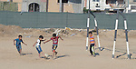 Boys play football in Shejaiya, a Gaza neighborhood which bore the brunt of some of the most intense Israeli air attacks during the 2014 war. Throughout Gaza, members of the ACT Alliance are supporting health care, vocational training, rehabilitation of housing and water systems, psycho-social care, and a variety of other humanitarian activities.