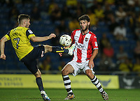 Dan Crowley of Oxford United & Alex Byrne of Exeter City in action during the The Checkatrade Trophy match between Oxford United and Exeter City at the Kassam Stadium, Oxford, England on 30 August 2016. Photo by Andy Rowland / PRiME Media Images.