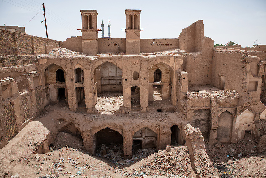 Ruins of an old mud brick building with intact wind tower or called badgir around Yazd Bazaar. Yazd is one of the oldest living city in the world. Yazd was visited by Marco Polo in 1272, who described it as a good and noble city and remarked its silk production. The name Yazd means worship. And badgir or the wind tower, is one of distinctive feature of this city.